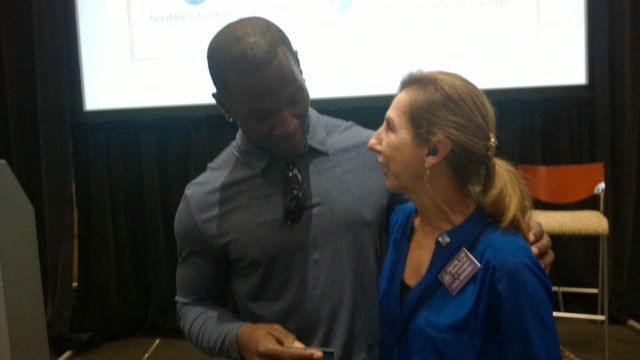 Derrick Coleman with Let's Loop Seattle founder Cheri Perazzoli.