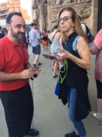 Getting help with the assistive listening system at Sagrada Famiglia.